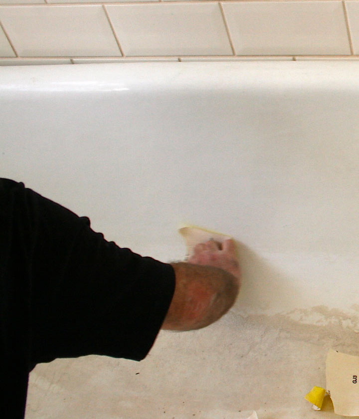 Sanding the surface of the bath