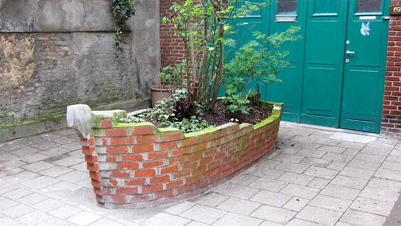 Landscaping with recycled red bricks